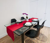Dining table with red cloth — Stock Photo