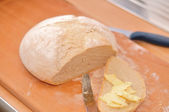 Homemade bread with butter — Stock Photo
