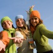 Group of happy girls arms outstretched in welcome — Stock Photo