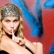 Young woman with finger up to lips for silence — Stock Photo
