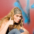 Trendy teen with thumb up for success or agreement — Stock Photo #6949979