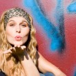 Happy young woman blowing kiss or kisses — Stock Photo #6949981