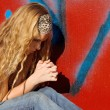 Christian girl or teen saying prayers, hands clasped praying — Stockfoto
