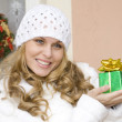 Woman holding wrapped gift or present — Lizenzfreies Foto