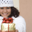 Happy girl giving christmas holiday or birthday gift or present — Stock Photo #6949995
