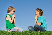 Christian children praying outdoors at prayer group or bible camp — Stock Photo