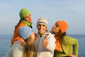Happy boy surrounded by girls blowing kisses — Stock Photo