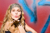 Happy young woman blowing kiss or kisses — Stock Photo