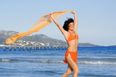 Happy woman running on beach on vacation in mallorca — Stock Photo