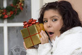 Excited girl with surprise gift or present — Stok fotoğraf
