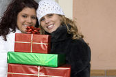 Young bringing christmas or birthday party gifts — Stock Photo