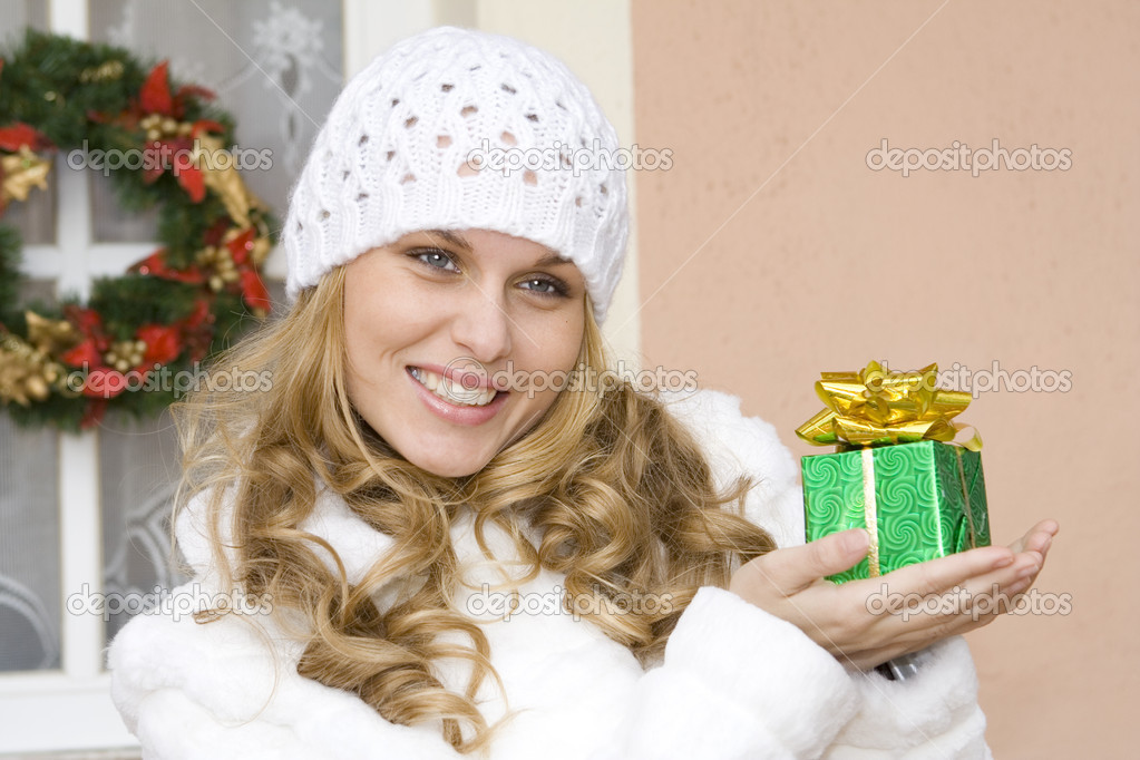 Woman holding wrapped gift or present — Stock Photo #6949993