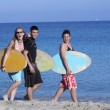 Group of healthy active kids at beach with surf boards — Stock Photo