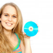 Young woman or teen holding blank cd or dvd disc — Stock Photo #6950028