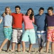 Group of diverse students on summer or spring break holiday or vacation at - Stock Photo