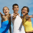 Foto de Stock  : Happy group of teens or youth singing