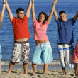 Mixed race group of teens on summer vacation or spring break holiday - Stock Photo