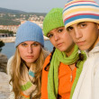 Group of trendy fashion teens in knitwear, knitted hats and scarfs — Stock Photo
