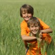 Happy healthy fit active children or kids playing piggyback outdoors — Stock Photo