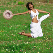 Happy healthy young woman jumping in summer or spring — Stock fotografie