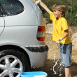 Stock Photo: Kid playing having fun cleaning or washing car