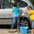 Stok fotoğraf: Kids washing car doing chores,