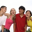 Happy group of teens or students — Foto de Stock