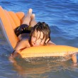 Stock Photo: Young kid floating in seplaying on airbed or lilo