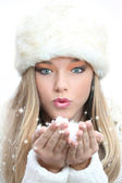 Beautiful girl blowing christmas or new year wishes — Stock Photo