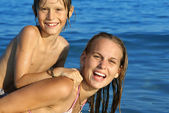 Young family, mother and son playing on beach on summer holiday or vacation — Stock Photo
