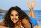 Beautiful happy smiling woman relaxing sunbathing on beach — Stock Photo