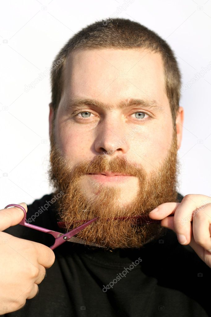 Bearded man trimming or cutting beard with scissors — Stock Photo #6950054