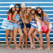 Foto Stock: Diverse group of girls going to beach on summer vacation