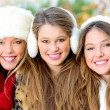 Group of winter girls or young women with perfect white teeth — Stock Photo
