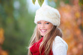 Happy smiling autumn woman with fur hat — Stock Photo