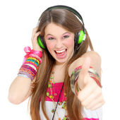 Teen with headphones and thumbs up — Stock Photo