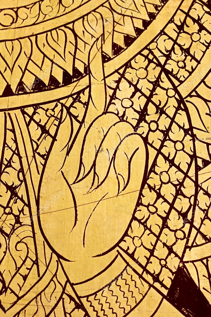 Patterned gold angels in art, arms and hands of the mural. — Stock Photo #6843533