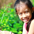 Portrait little girl in a garden — Stock Photo