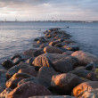 Pier from stones on a sunset — Stockfoto