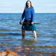 Man in scottish costume in the water — Stock Photo #6884895