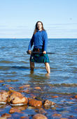 Man in scottish costume in the water — Stock Photo