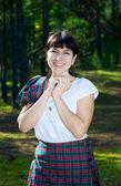 Smiling woman in scottish costume — Stock Photo