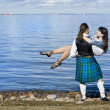 Man in scottish costume holding woman — Stock Photo #7223164