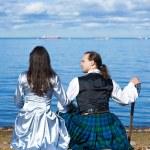 Woman and man in scottish costume near the sea — Stock Photo #7271522