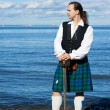 Man in scottish costume with sword — Stock Photo