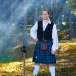 Brave man in scottish costume with sword — Stock Photo #7410903