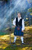 Brave man in scottish costume with sword — Stock Photo