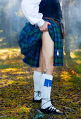 Legs of the man in kilt — Stock Photo