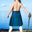 Mwith naked torso in kilt — Stock Photo #7434331