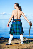 Man with naked torso in kilt — Stock Photo